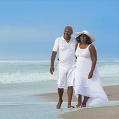 older-couple-walking-beach